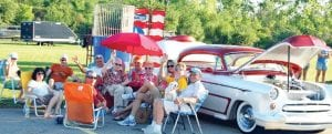 Families and friends gather at the annual West Flint Car Cruise and Family Fun Festival