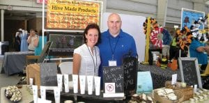 Bekah and Steve Townsend, of Gladwin, proudly display their goods – Hive Made Products – at the Honey Festival.