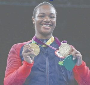 Flint's Claressa Shields displays her two gold medals at a press conference at Bishop Airport on Tuesday.