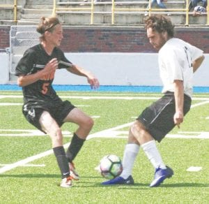 Carman-Ainsworth's Zack Lloyd-Amthor (right) battles for the ball with Fenton's Brady Young.