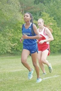 Carman-Ainsworth's Mikaiah Holbrook runs the course at the Genesee Invite last Saturday.