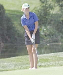 Carman-Ainsworth's Sloan Barclay watches a putt roll.