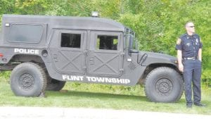 An officer gave NNO visitors a look inside the township's Humvee crime-fighting vehicle
