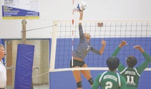 Carman-Ainsworth's Cashae Harris attempts to put away a kill against Northwestern.