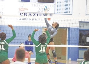 Diamond Lester goes up for a kill during a match with Northwestern Sept. 20.