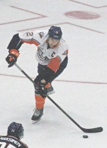 Flint Firebirds' captain Alex Peters looks to clear the defensive zone in the season opener.