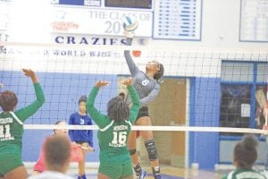 Carman-Ainsworth's Diamond Lester goes up for the kill attempt.