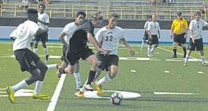 Carman-Ainsworth's James Avery battles with a Fenton defender for the ball.