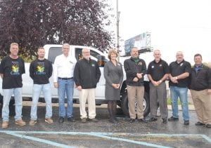 Staff from Genesee County Habitat for Humanity and General Motors beside the newly donated vehicle.