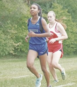 Carman-Ainsworth's Mikaiah Holbrook is the Cavs' top girl runner heading into regionals.