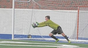 Carman-Ainsworth goalkeeper Spencer Fiewig lays out to make the save.