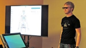Students don 3D glasses while working with Z space equipment where they can virtually dissect a human body or examine a running car engine.