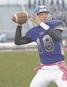Carman-Ainsworth's Dustin Fletcher looks down field for his target against Lapeer on Oct. 21.