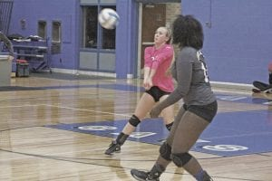 Katie Speaks bumps the ball to the front line during Carman-Ainsworth's match with St. Johns last Wednesday.