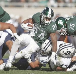 Gerald Holmes in action for the Spartans against BYU.