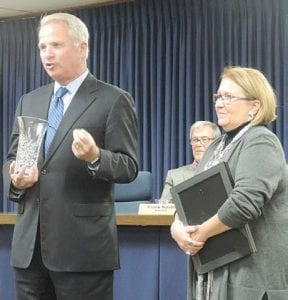 County prosecutor David Leyton helped with the sendoff for Clerk Kim Courts.
