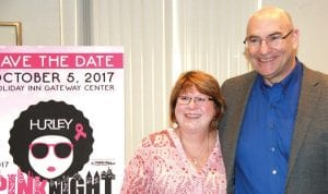 Hurley Medical Center's Breast Health Nurse Navigator Marsha Schmit, RN, BSN, CBCN, guides women through the complex treatment options and the difficult journey that breast cancer presents. Schmit was thrilled to accept a total of $8,219 from Halo Burger's Beefy Double Fundraiser on behalf of Hurley's Breast Health Navigator Fund on Tuesday at Hurley Medical Center. Here, Schmit poses with Paul Warren, the COO of Halo Country LLC, which owns Halo Burger.