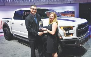 Jamie Page Deaton (right), managing editor, Autos, U.S. News & World Report presents the magazine's Best Truck Brand award to Dan Gray, marketing development manager, West Market Area, Ford Motor Company.