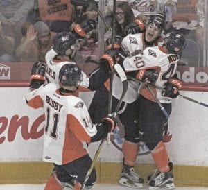 The Flint Firebirds celebrate after scoring a goal against Saginaw.