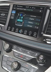 The Pacifica Hybrid comes standard with the Uconnect 8.4 system, which includes an 8.4-inch touchscreen (left) and a 7-inch color thin-film transistor (TFT) instrument cluster that is unique to the hybrid model.
