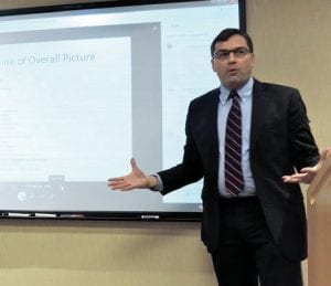 Martin Lavelle, left, business economist for the Federal Reserve Bank of Chicago/Detroit presented a 2017 outlook for Michigan at Baker College-Flint.
