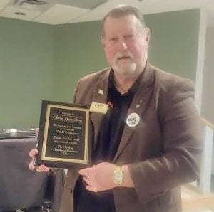 Chris Hamilton was presented a plaque for his dedication as executive director of the Old Newsboys at the recent roast of him.