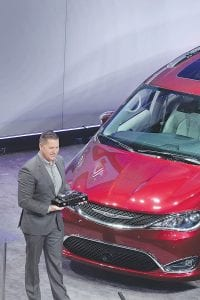 Timothy Kuniskis, Head of Passenger Car Brands - Dodge, SRT, Chrysler and FIAT, FCA - North America, accepts the award for the Chrysler Pacifica minivan. The Pacifica was named North American Utility Vehicle of the Year at the North American International Auto Show in Detroit.