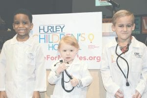 "Three of Hurley Children's Hospital's ""Miracle Kids"" were on hand to help accept two checks after winning the #VoteForMiracles contest. Will Morgan, 6, of Flint, Hadlee Deines, 3, of Durand, and Easton Clark, 5, of Goodrich, attended the celebration held at Hurley Medical Center on Monday, Jan. 30."