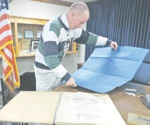 Flint Township now has its very own copy of a 1907 Standard Atlas of Genesee County, presented by Trustee Tom Klee.