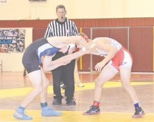 Carman-Ainsworth's Nathan Delong faces off with a Swartz Creek opponent on Dec. 17.