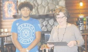Jonathan Powell from Carmen Ainsworth was presented his Rotary Student of the Month award by high school principal Debbie Davis. The other winner, Jahanna Miller-Thompson did not attend the awards ceremony.
