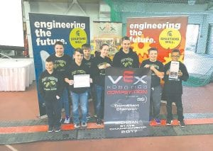Two robotics teams from Carman-Ainsworth Middle School won the championship at the VEX state tournament in East Lansing last weekend.