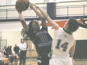 Shakara Johnson shoots over a Powers Catholic player.