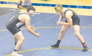 Carman-Ainsworth's Grayden Hamilton squares up an opponent during Saturday's Div. 1 individual regional competition at Oxford.