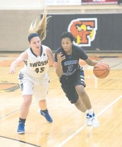 Carman-Ainsworth's Destiny Strother was limited to six points against Flushing in the district final at Flushing last Friday.