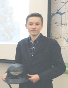 Lucas Hartwell shows a helmet issued to the Luftschutz, a volunteer civilian arm of the Nazi war machine.