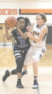 Carman-Ainsworth's Chenelle King drives to the basket against Flushing. The Cavs and the rest of the SVL will see some changes within the league as early as next season.