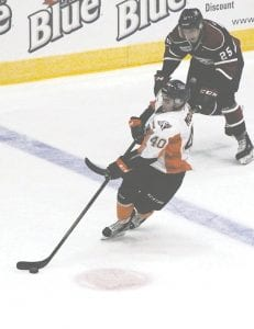 Flint's Ryan Moore picks up speed as he lugs the puck through the neutral zone.