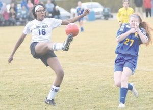 Defender Jasia Caldwell gets rid of the ball as a Kearsley opponent approaches at Carman-Ainsworth Monday.