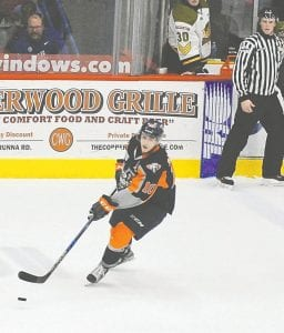 Flint's Nicholas Caamano gains control of the puck in the neutral zone.