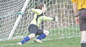 Carman-Ainsworth keeper Arianna Vantine is a key cog in the soccer program that is seeing its largest numbers since 2000.