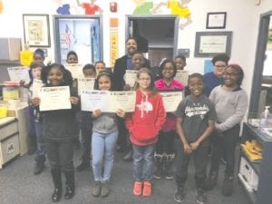 Dr. Recco Richardson, (center, rear) sponsor of a Black History Month Research Writing Contest, is shown here with contest winners and participants from Randels Elementary School.