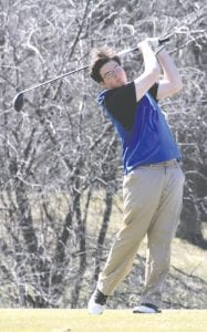 Carman-Ainsworth's John Karbowski holds his swing after a shot at last year's Tune- Up. Carman-Ainsworth was a late entry into this year's Tune-up.