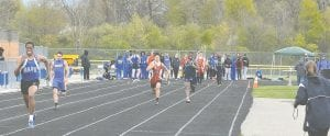 Carman-Ainsworth's Marshall Brooks leads the group during the 400 relay at the Jon Runyan Classic last Friday.