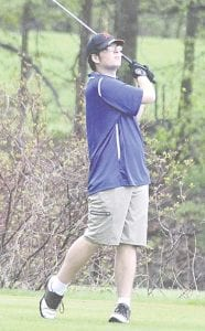 Carman-Ainsworth's John Karbowski holds his swing after a tee shot at Davison on May 1.