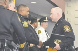 Officer John Roland is congratulated on finishing police training.