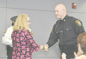 Flint Township Clerk Kathy Funk was on hand to congratulate Justin Dieck, one of two new township police officers who graduated from the police academy last week.