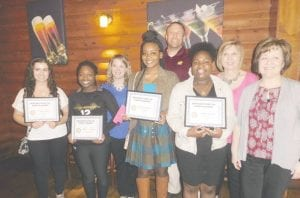 Rotary Students for the months of March and April are (L-R) Leticia Silva, Chelsea Pearson, En'Dea Haygood and Ocher Benson, all seniors, shown with C-A teachers and administrators