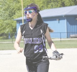 Carman-Ainsworth's Hannah Thurston watches the batter after delivering a pitch on Monday against Bay City Western.