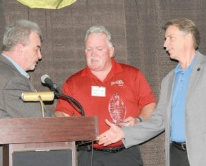 John Matonich, the board secretary for the Food Bank of Eastern Michigan (left), presented Steve Dawes (center) and Norwood Jewell, both of UAW, with the Community Leadership Award. Dawes and Norwood also presented Matonich and the Food Bank with a check for $10,000 while accepting their award.
